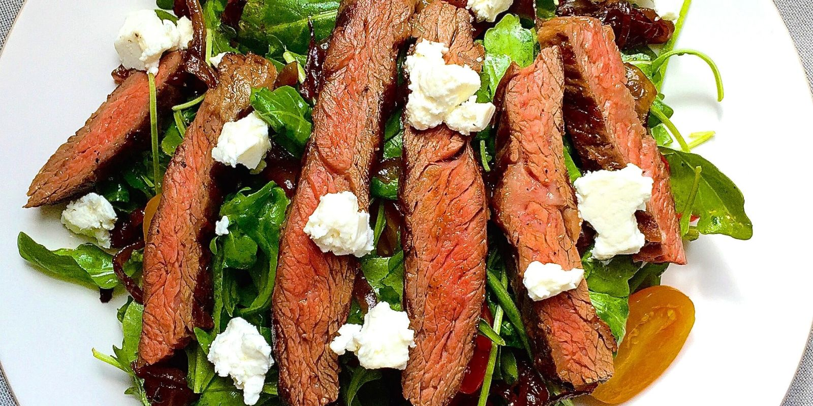 Grilled Skirt Steak Salad with Arugula, Balsamic-Glazed Onions, Tomatoes, and Feta