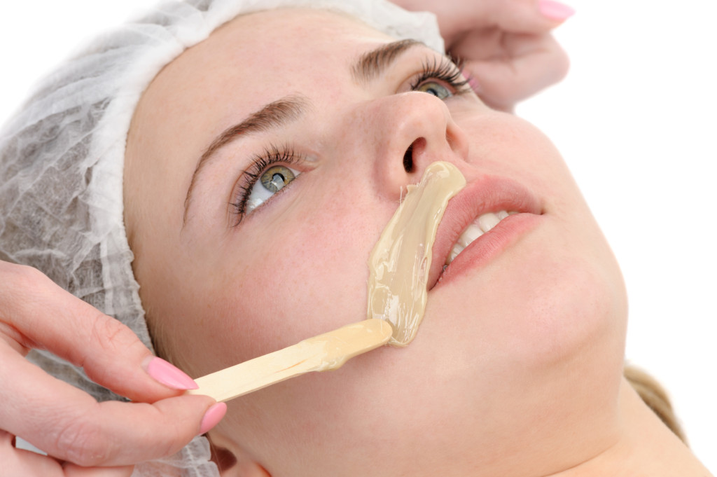 beauty salon, mustache depilation, facial skin treatment and care; focus on upper lip