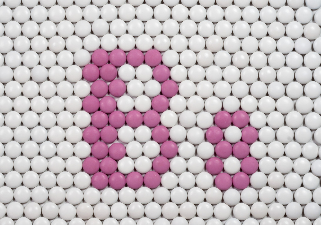 Vitamin B 8 made of tablets on background of pills